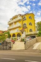 Yellow residential apartment hotel building Crikvenica Croatia. photo