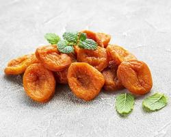 Dried apricots on a table photo