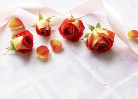 Flowers composition. Frame made of red  roses and petals photo
