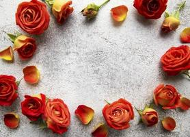 Flowers composition. Frame made of red  roses and leaves photo