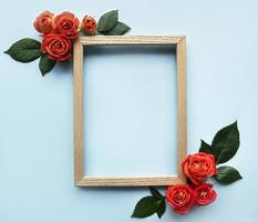 Flowers composition. Wooden frame and red  roses photo