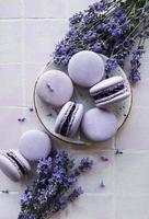 French macarons with lavender flavor and fresh lavender flowers photo