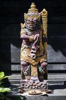 Traditional ancient Balinese Hindu statues in Bali temple Indonesia photo