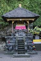 Traditional Balinese Hindu shrine in Pura goa Lawah 'bat cave' famous landmark temple in Bali Indonesia photo