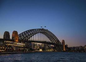 Sydney city harbor bridge and circular quay passenger terminal in Australia at night photo