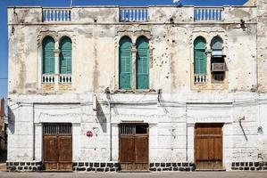 Local red sea style architecture street in central Massawa old town Eritrea photo