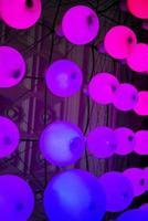 Colorful round pink lights in funky modern interior design detail photo