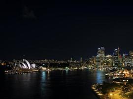 Sydney harbor CBD opera house skyline famous landmarks in Australia at night photo