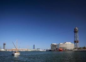 World trade center and Barcelona port vell cable car Jaume I tower in Spain photo