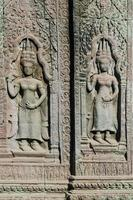 Ancient Asian stone carved figures in Buddhist Angkor Wat temple Cambodia photo
