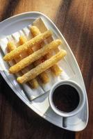 Churros and chocolate Spanish donuts pastry doughnuts with sauce breakfast snack photo