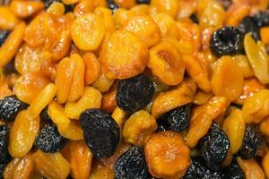 Healthy natural honey glazed sundried dried apricot and prune fruit mix photo