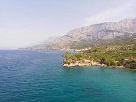 Blue lagoon, Beautiful bay near Podgora Makarska rivera Croatia photo