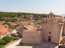 Bay and old city with church in Vrboska on Hvar island Croatia photo