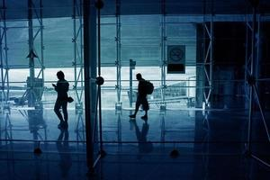 People walk down the hall airport photo