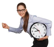 Girl with glasses runs with a clock in his hands photo