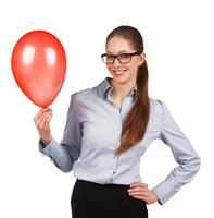 Girl in glasses with red inflated ball photo