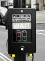 Wait sign at traffic light photo