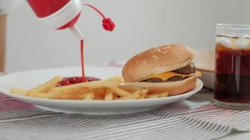 Ketchup and junk food in a white dish video
