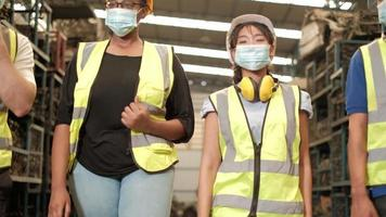 Diverse colleague workers in factory warehouse video