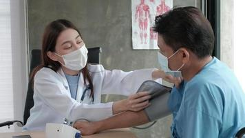 Doctor checks the health of handicapped man video