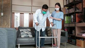 Asian female physiotherapist is rehabilitating a disabled male video