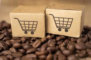 Box with shopping cart on coffee beans, Import Export photo