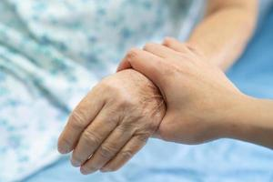 Holding Touching hands Asian senior woman patient with love, photo