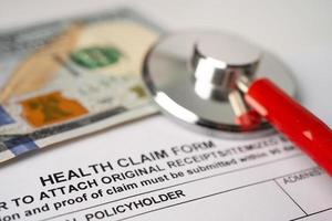 Health insurance accident claim form with stethoscope, photo