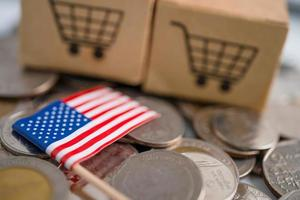 Stack of coins, shopping cart box with USA America flag photo