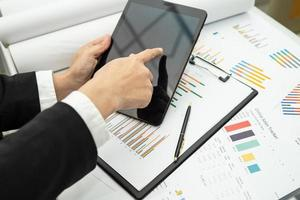 Asian accountant working and analyzing financial report photo