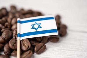 Israel flag on coffee beans, import export drink food concept. photo