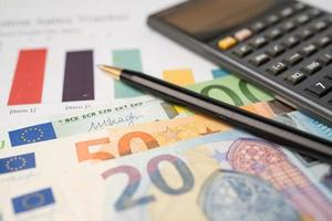 Euro banknotes money with calculator on chart photo