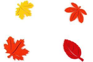 Yellow orange red autumn leaves, border frame, artificial plant photo