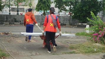 Two asian laborers carry the limiting zinc photo