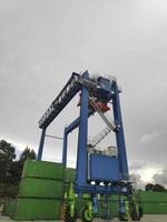 Sorong, West Papua, Indonesia 2021- A Rubber Tyred Gantry Crane on the yard of Sorong Harbour photo