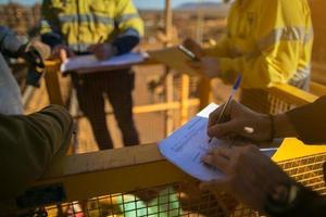 Rope access miner supervisor signed of JSA risk assessment permit photo