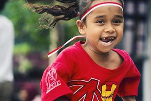 Sorong, Papua, Indonesia 2021- People celebrate Indonesia's independence day with various competitions photo