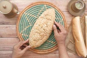 Top view of whole grain baked bread and tea cup on table photo