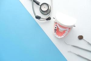 Plastic dental teeth model on color background photo