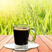 Black coffee on nature background. photo