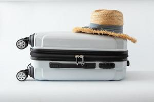 white luggage hat travel journey to destination long weekend holiday photo