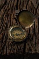compass navigator journey travel to destination on wwod background photo