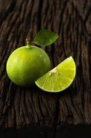 lime fresh sour taste from natural selection on wood background photo