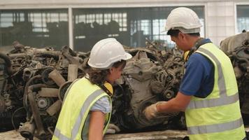 Asian engineers checking car spare parts in warehouse factory video