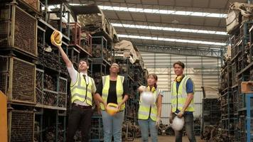 Workers of various races in auto parts warehouse factory video