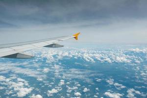 Wing of an airplane flying. photo