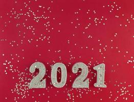 Greeting card of New Year 2021. Siver glitter figures and stars photo