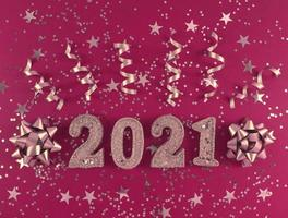 Greeting card of New Year 2021. Glittered figures, stars, bows photo