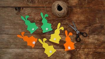 Easter bunnies made of paper on a wooden photo